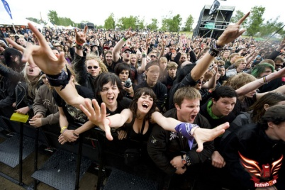 Soelvesborg, Sweden - June 2010:  Festival goers cheer during one of the live performances at the Sweden Rock Festival, June 9th-12th, 2010 (Photo by R. Nilsson)